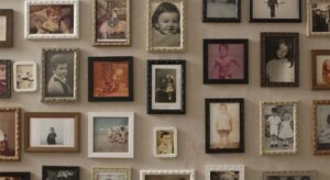 A shot showing framed pictures of several children, with a mix of colour and black-and-white.