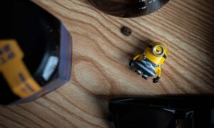 Yellow and black plastic toy on a wooden table