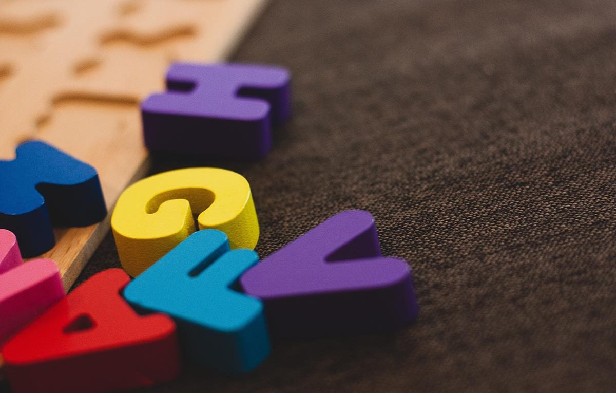 Alphabet learning toy on a gray apparel